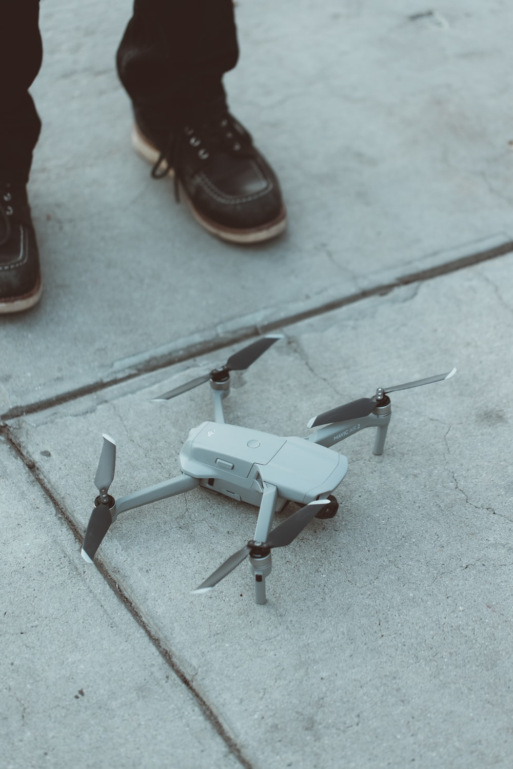 white quadcopter drone on floor
