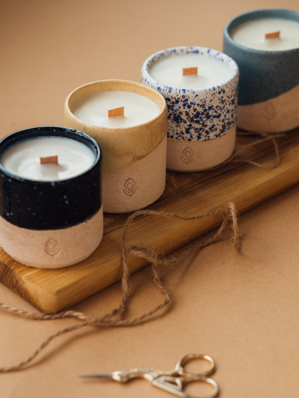 black and white candle on brown wooden holder