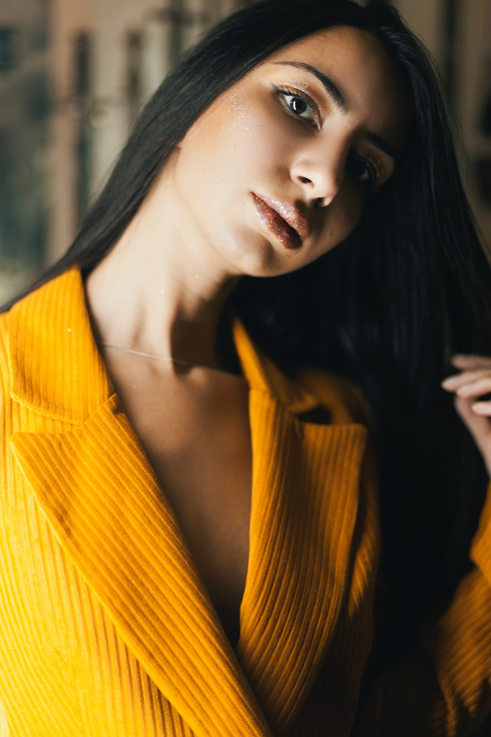 woman in yellow knit cardigan