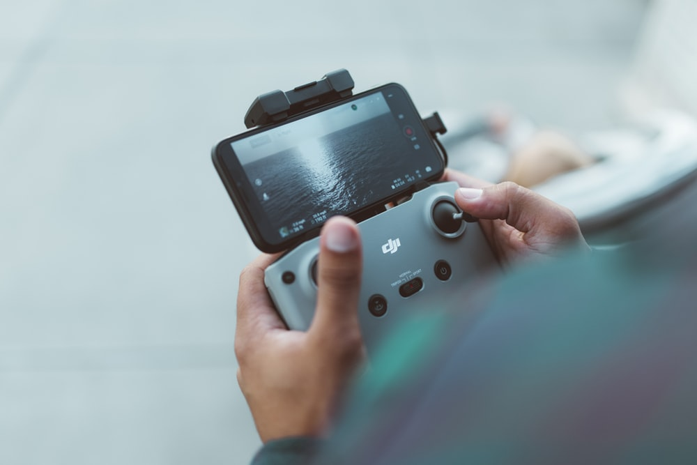 person holding red and black nintendo switch