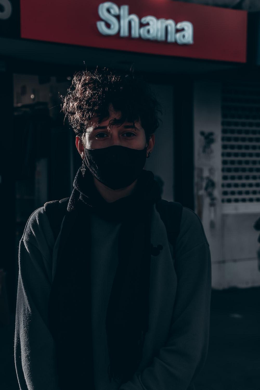 man in gray hoodie wearing black mask