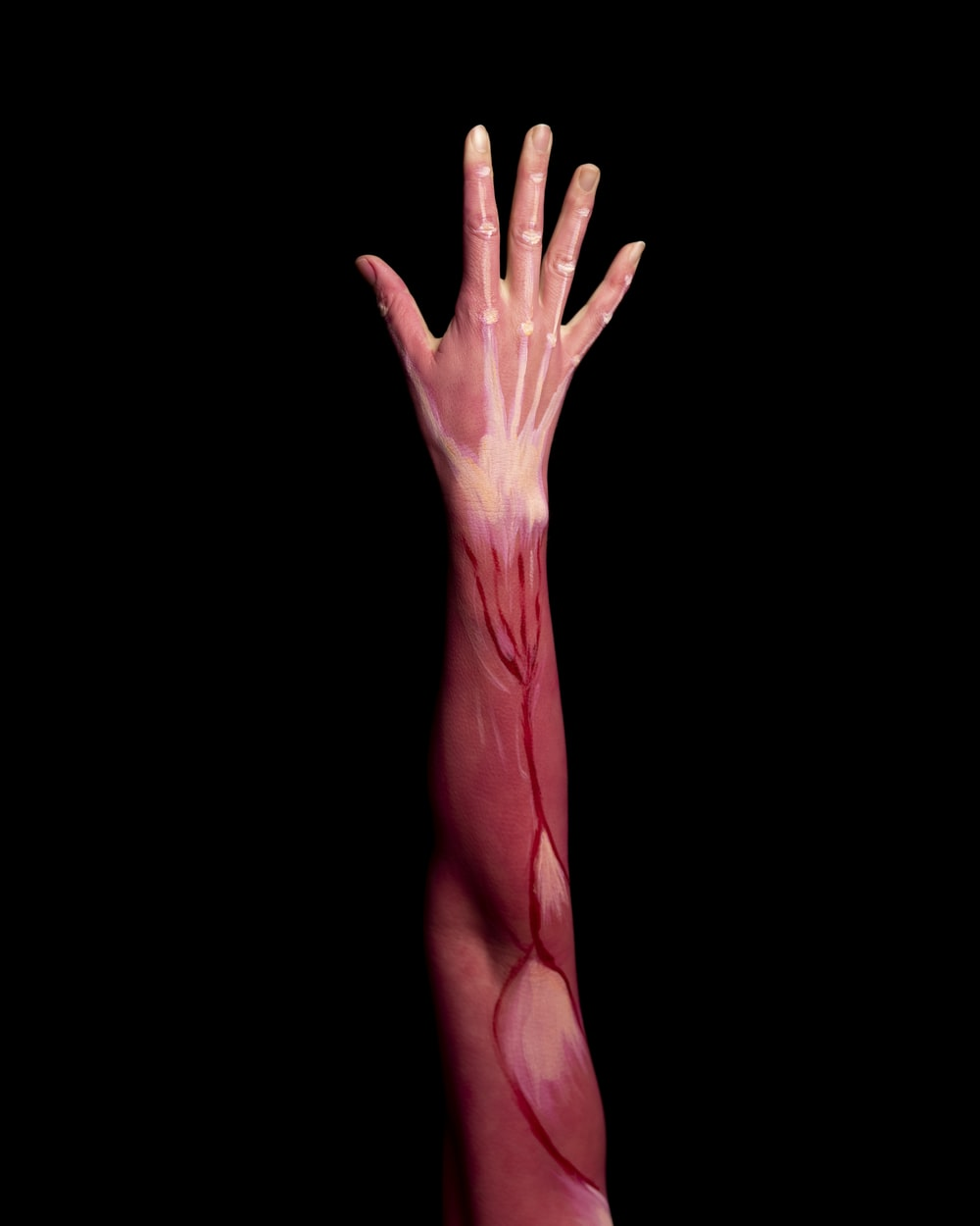 persons left hand with pink paint