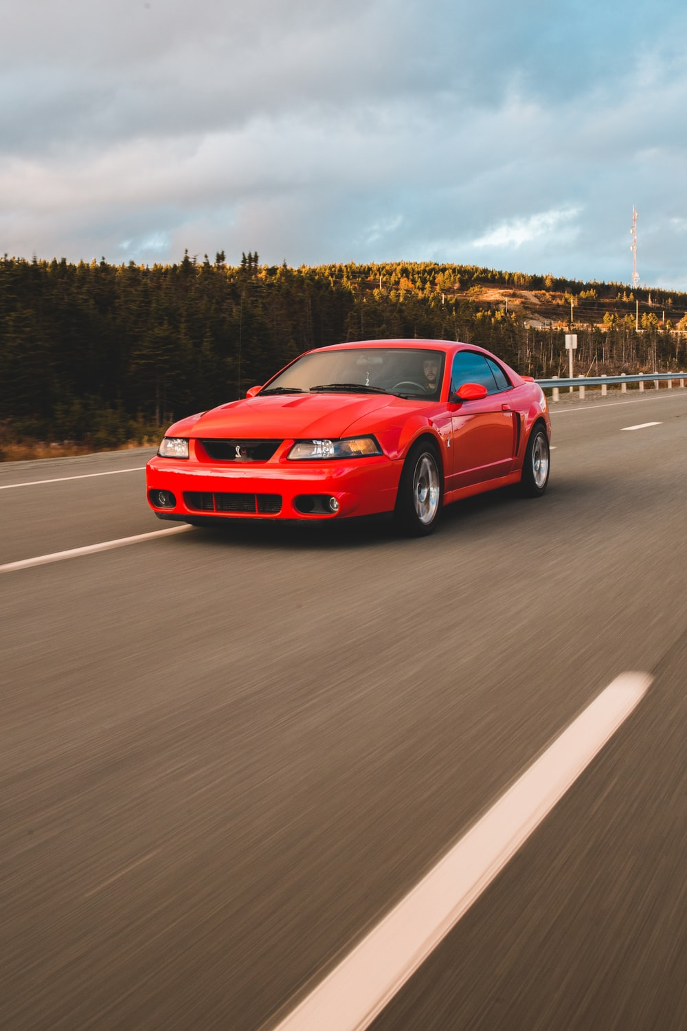 red bmw m 3 on road during daytime
