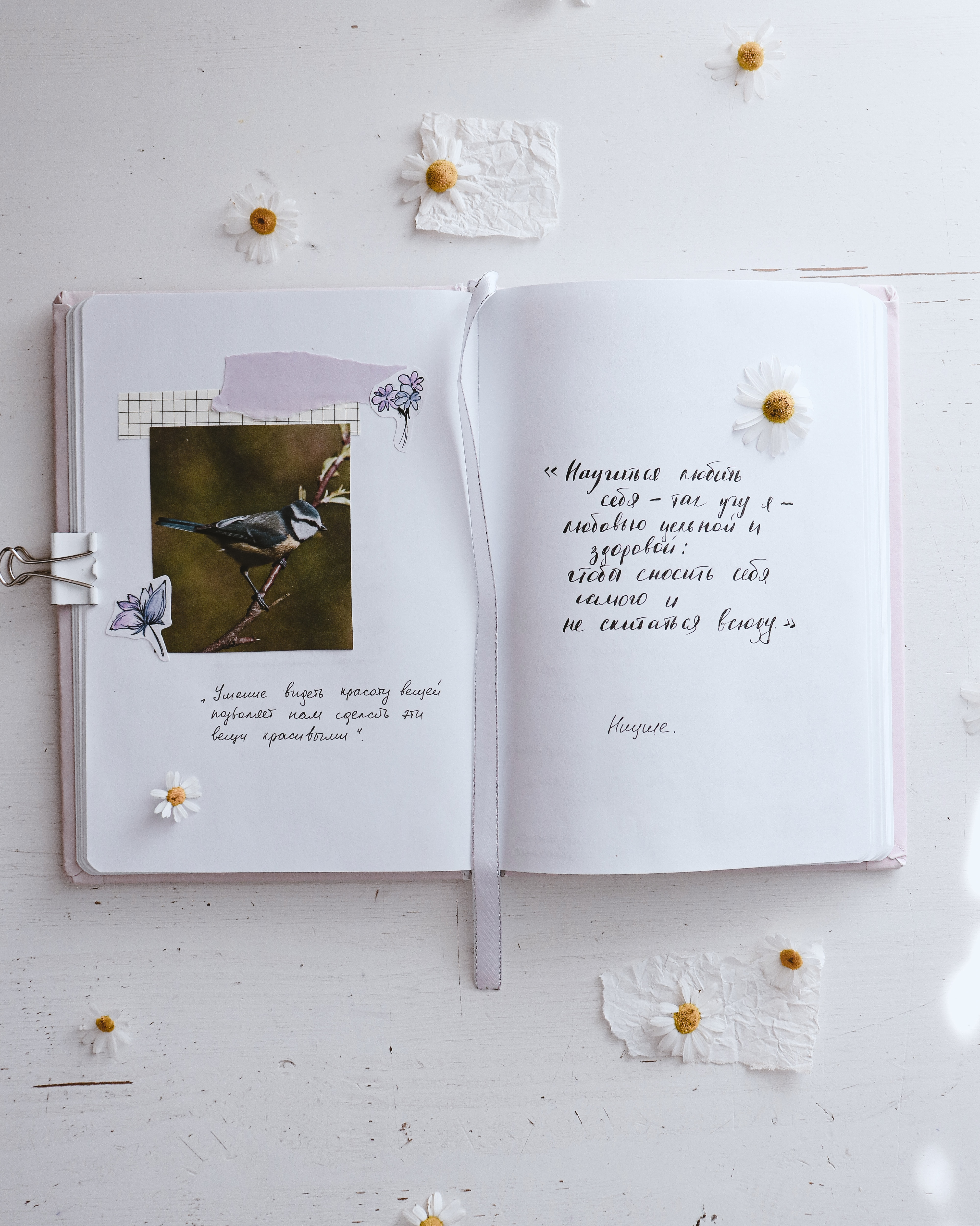 white greeting card on white table