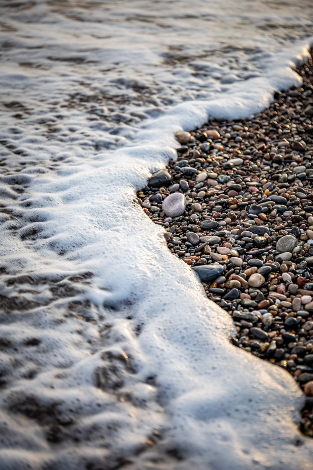 brown and black stones on seashore during daytime