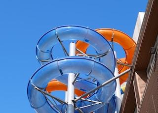 orange and gray ferris wheel under blue sky during daytime