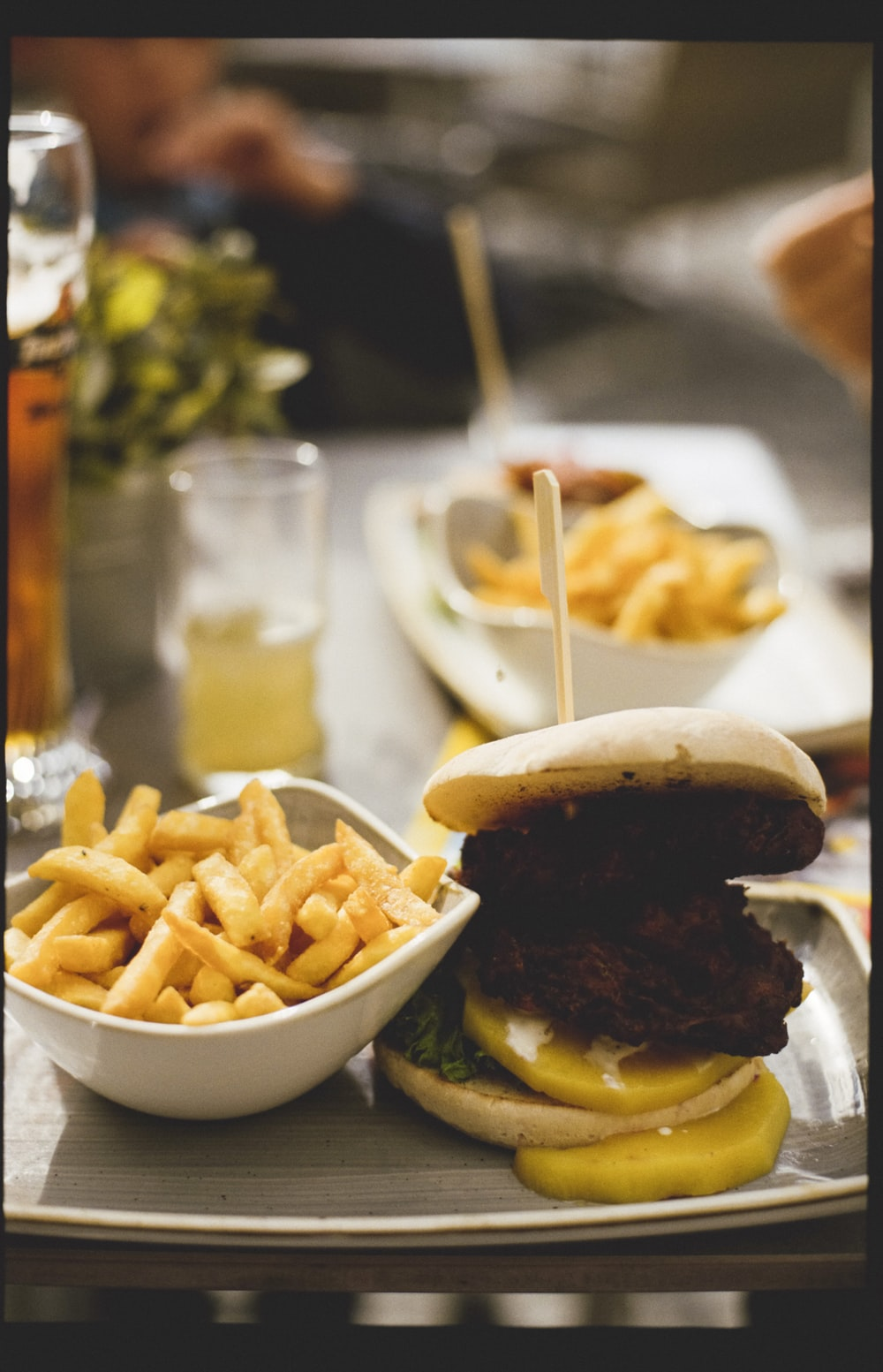 burger with fries on white ceramic plate