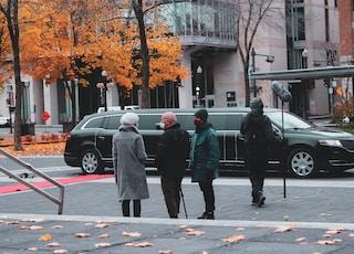 man in green coat walking on pedestrian lane during daytime