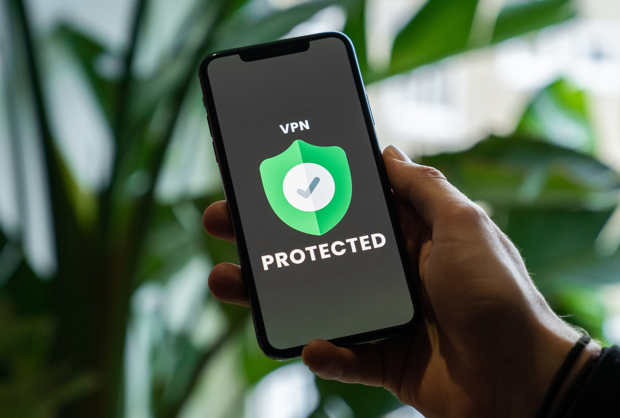 iPhone with VPN service enabled in hand
