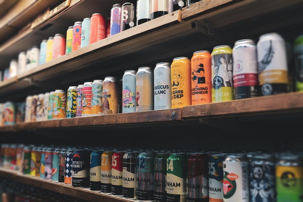 assorted plastic bottles on brown wooden shelf