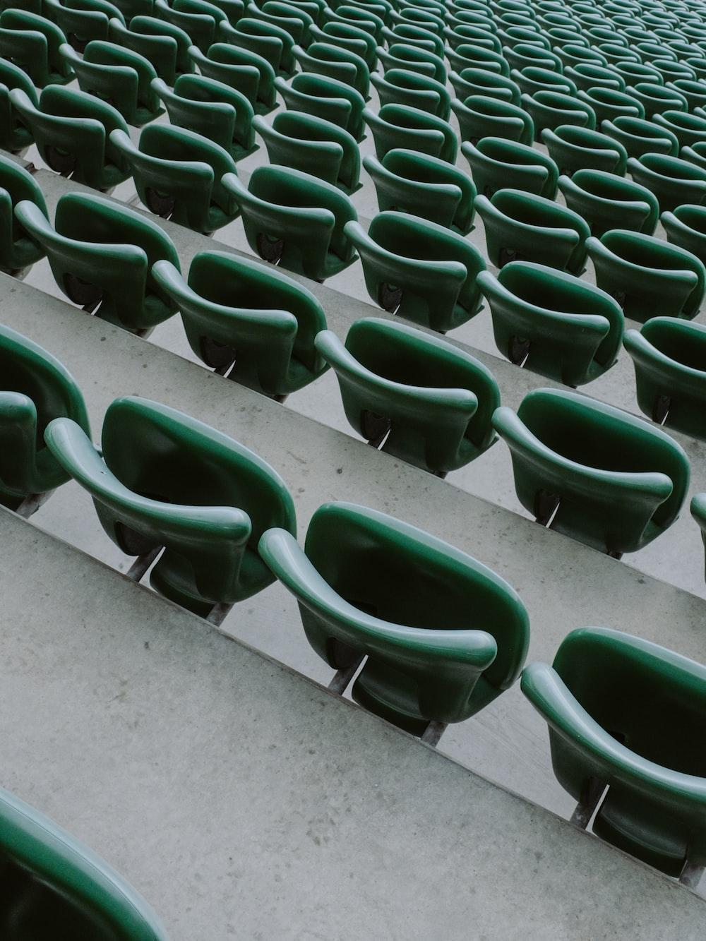 green plastic chairs on gray concrete floor