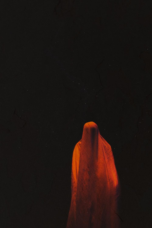 orange hand sign on black background