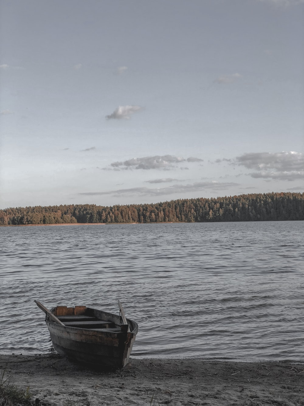 brown boat on body of water during daytime