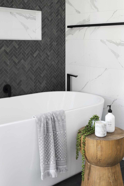white bathtub near white ceramic bathtub