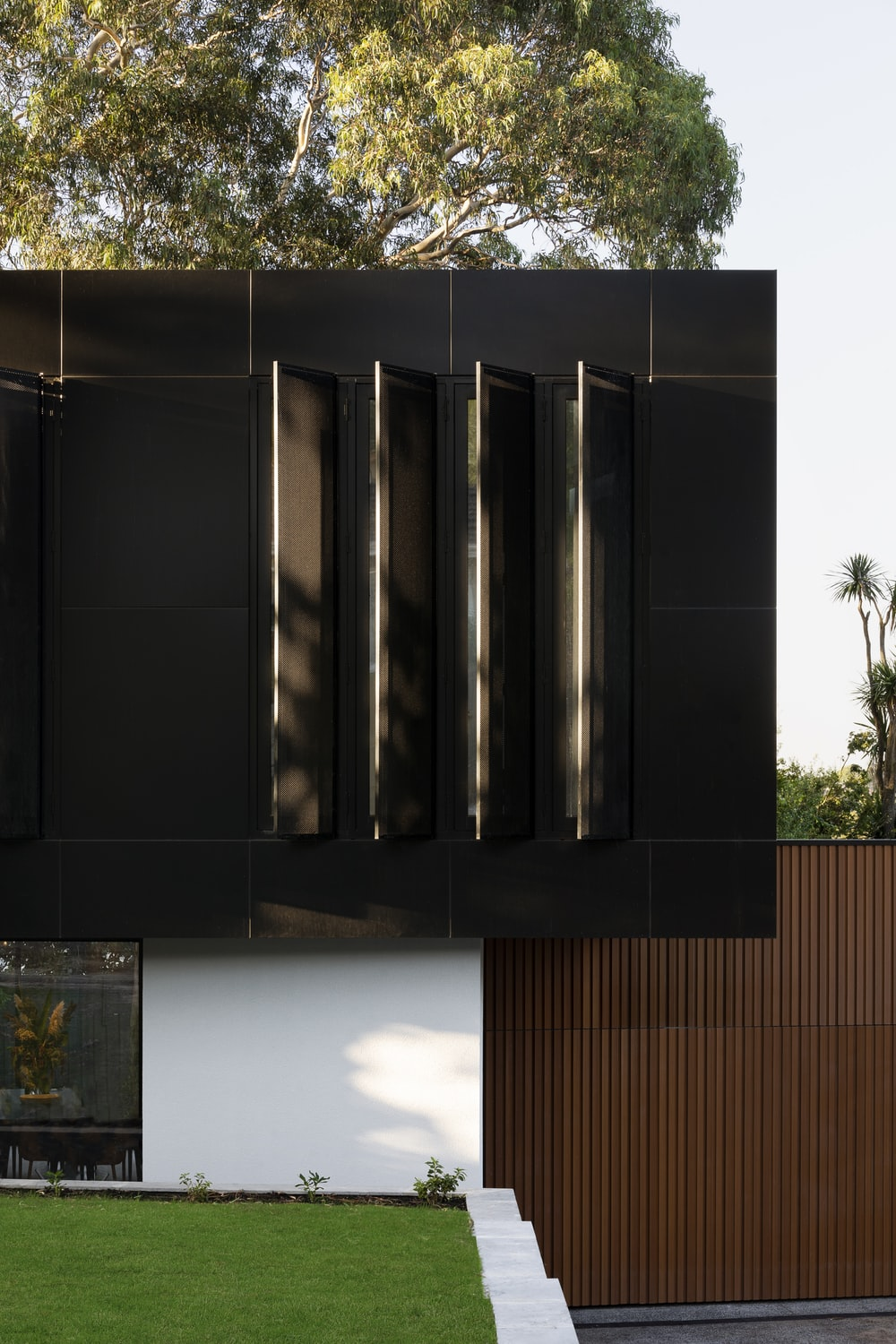 black wooden cabinet near green tree during daytime