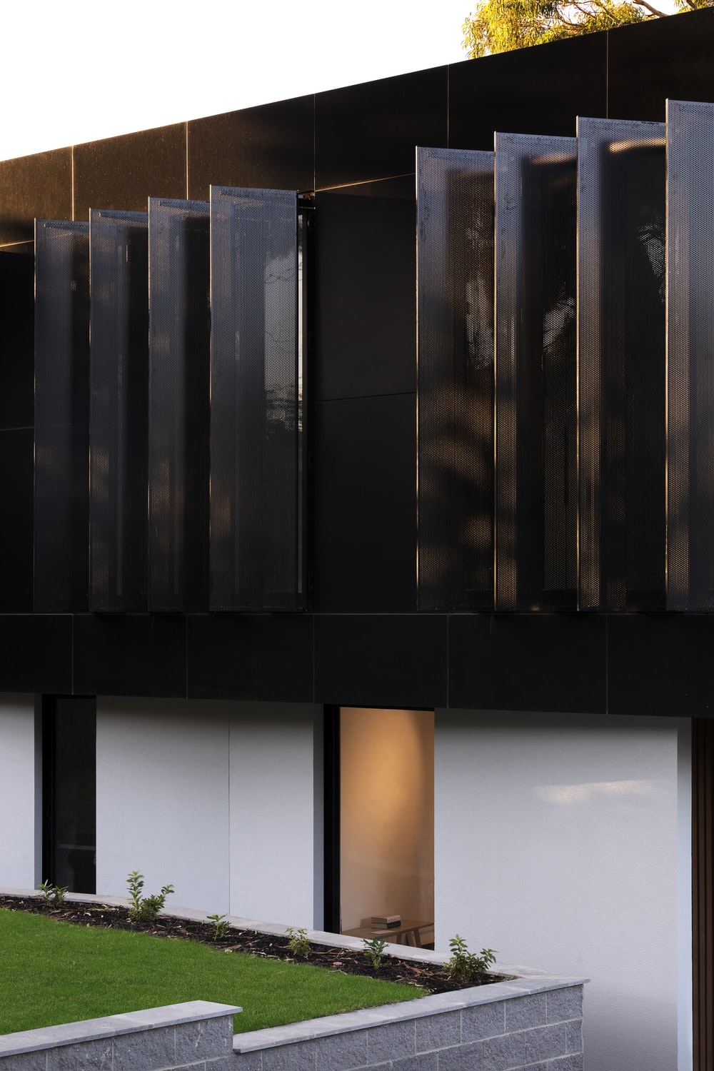 black wooden wall during daytime