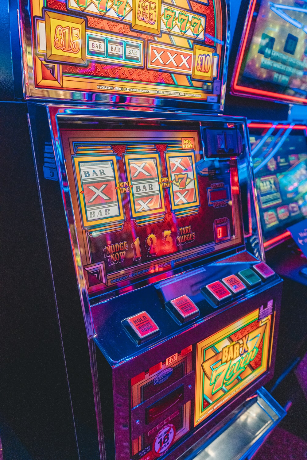 slot machine with lights turned on in the dark