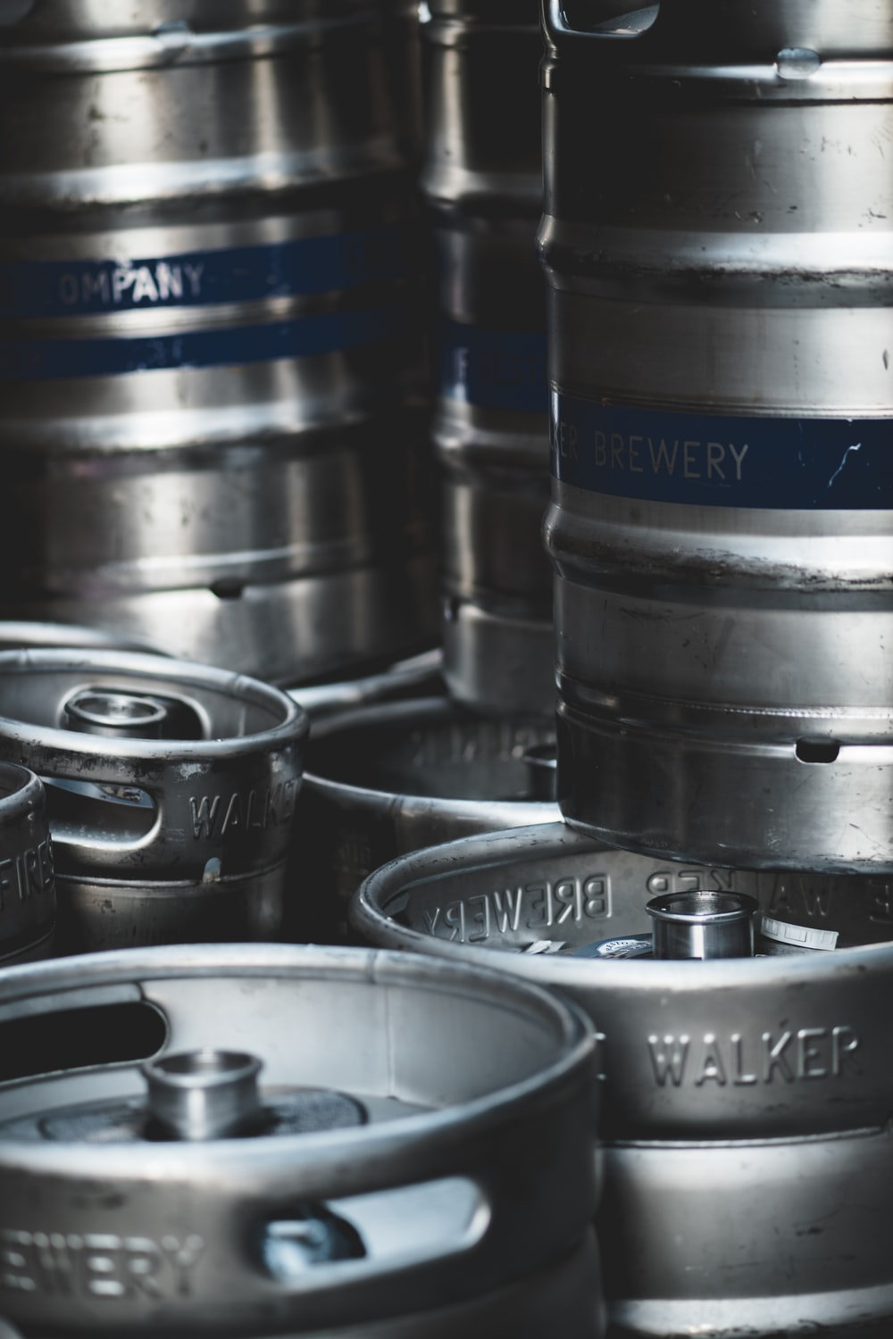4 stainless steel barrels on black plastic container