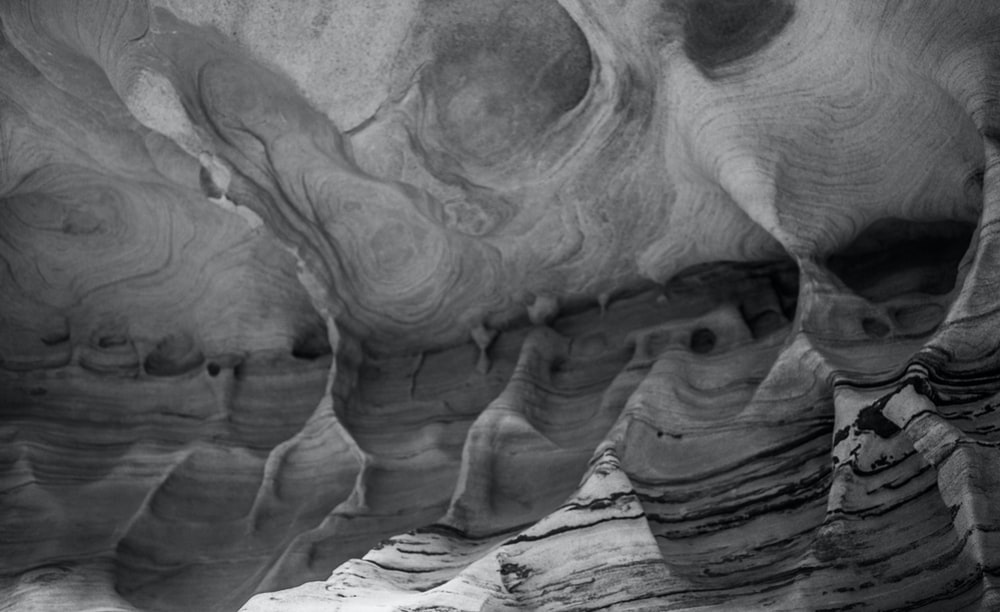 grayscale photo of rock formation