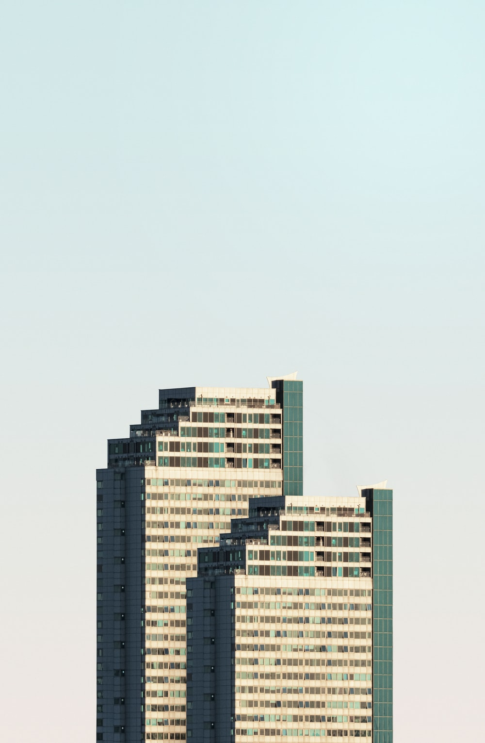 high rise buildings under white sky during daytime