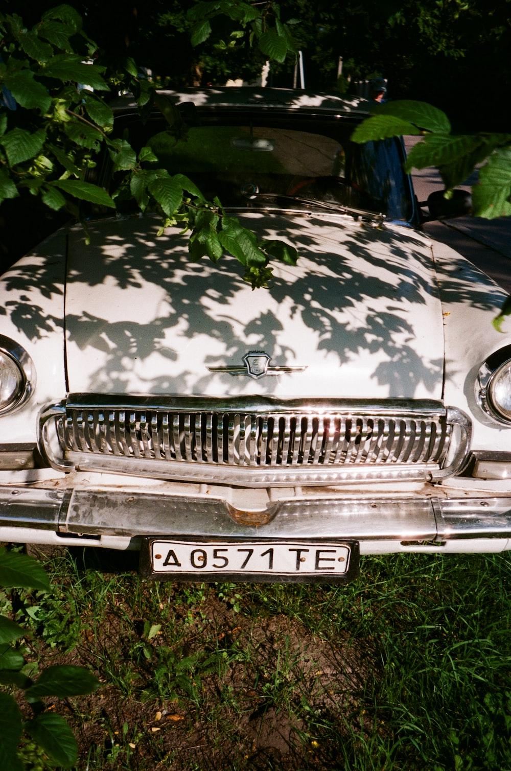 silver mercedes benz car on green grass field