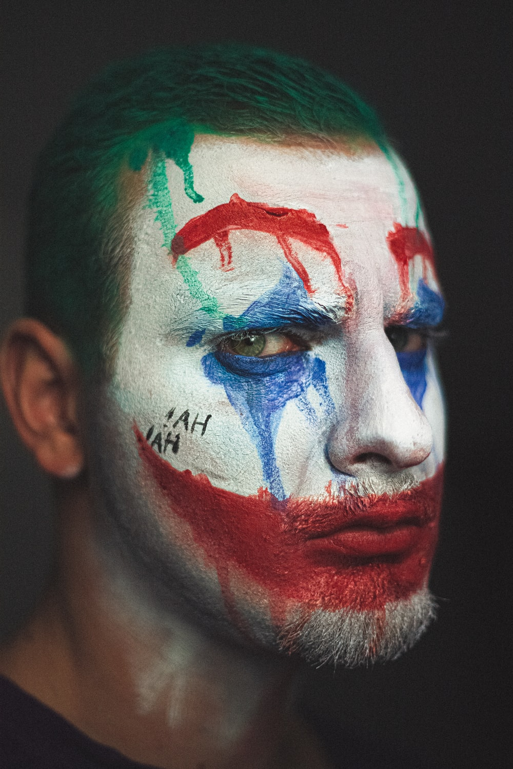 man with blue and red face paint
