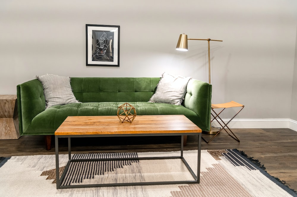 Green And White Sofa Beside White Wall Photo Free Table Image On Unsplash