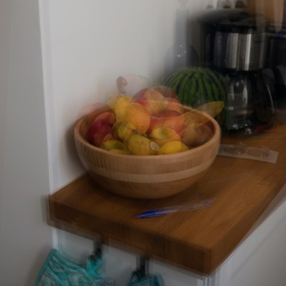 orange fruit on brown bowl