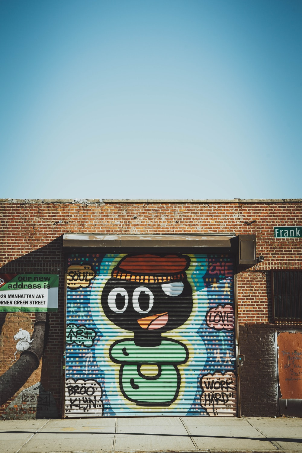 brown brick building with mickey mouse wall graffiti