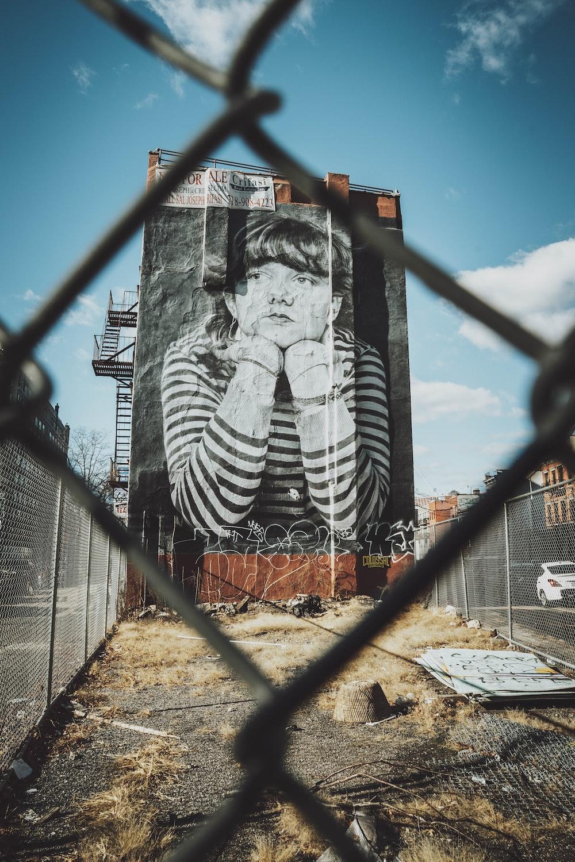 black and white zebra print on gray metal fence