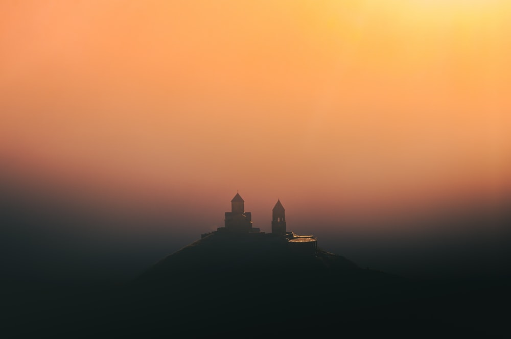 silhouette of castle during sunset