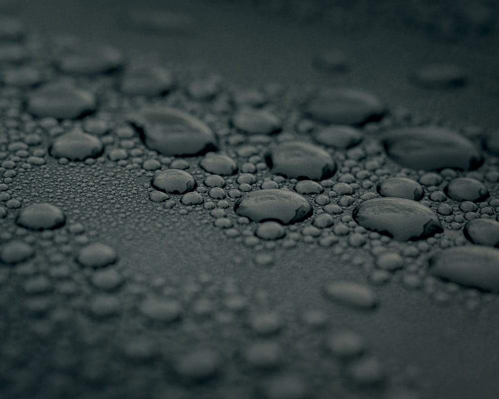 water droplets on gray surface