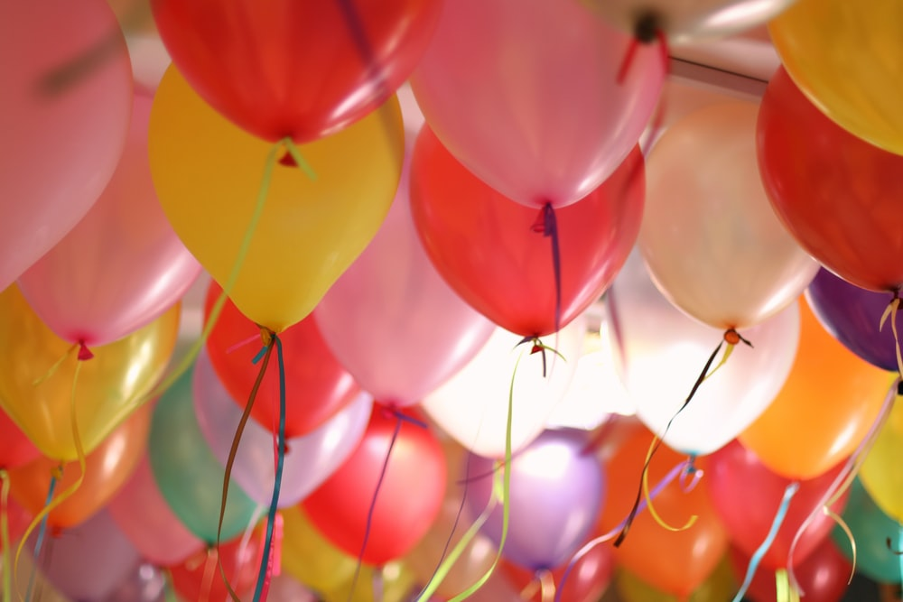 pink and yellow balloons in close up photography