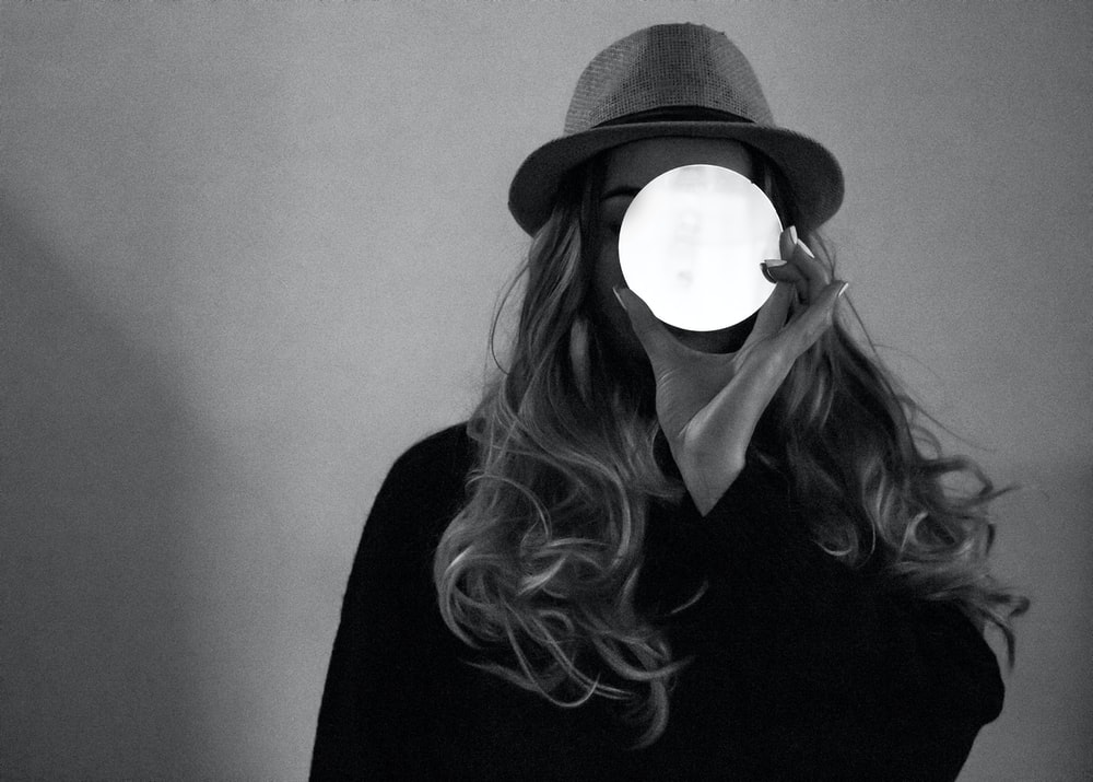 woman in black shirt wearing black hat