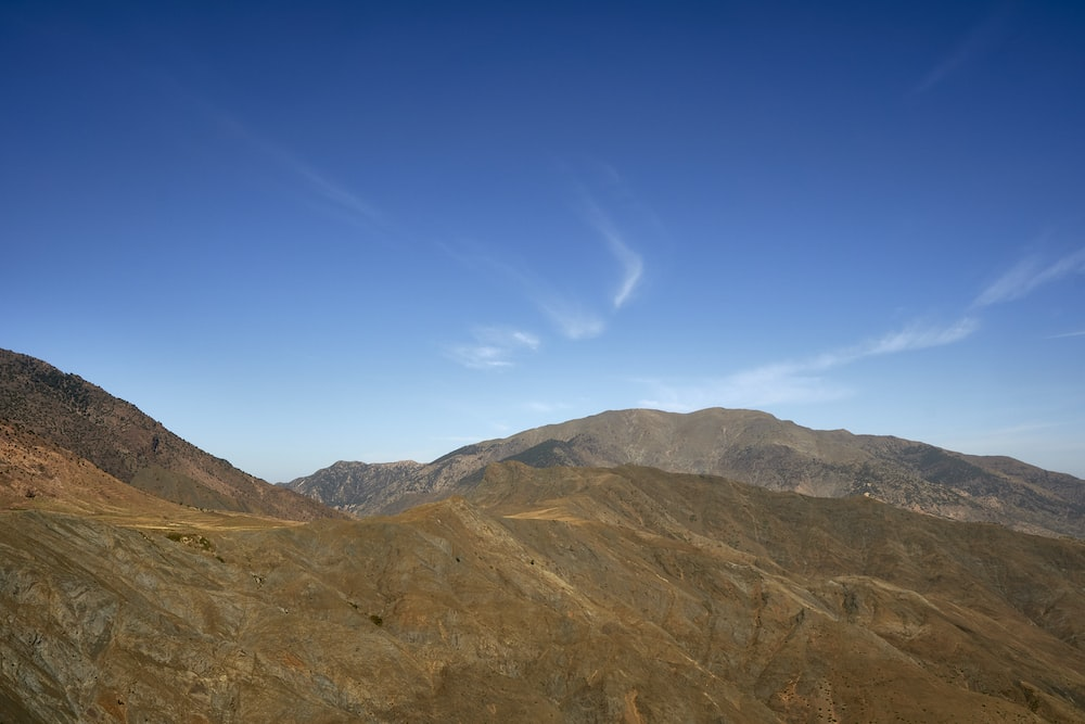 brown and green mountains under blue sky during daytime