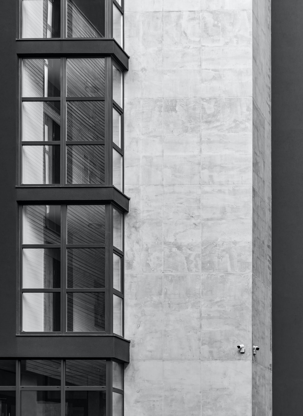 gray concrete building with glass window