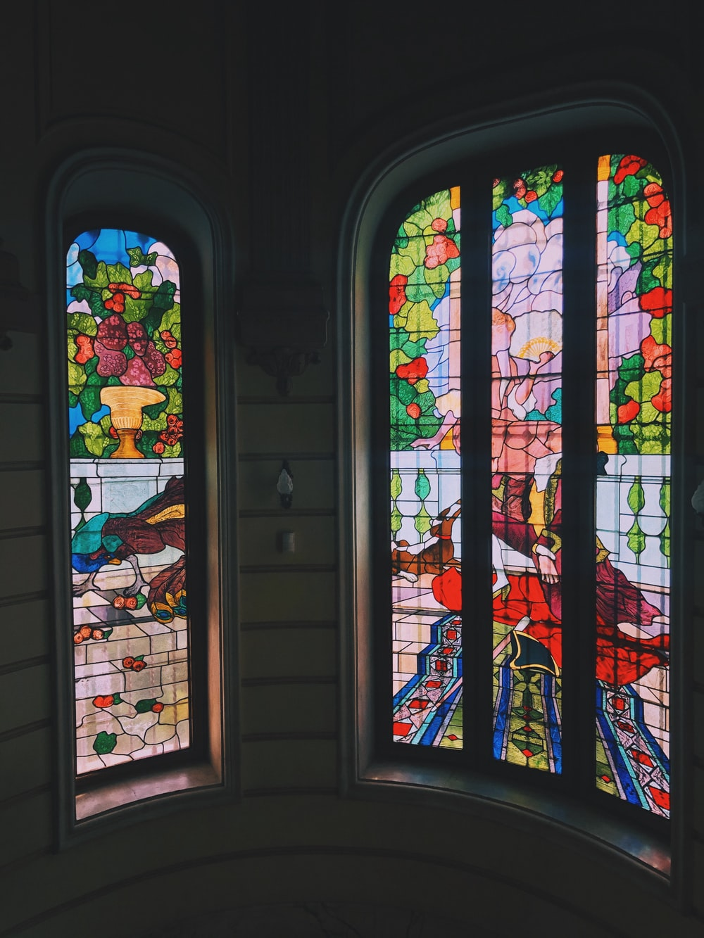 white blue red and green floral glass window