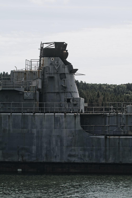 gray metal tank on water
