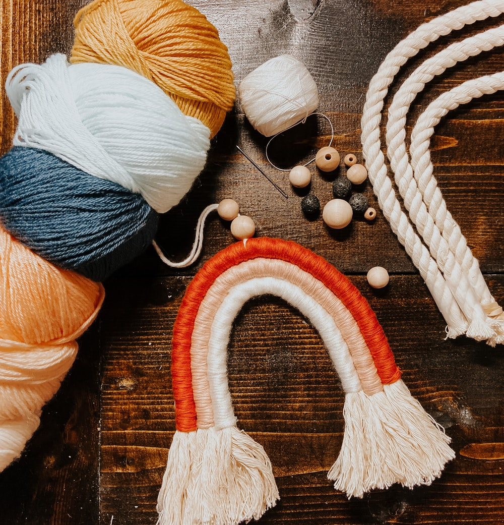 blue and orange yarn on brown wooden table