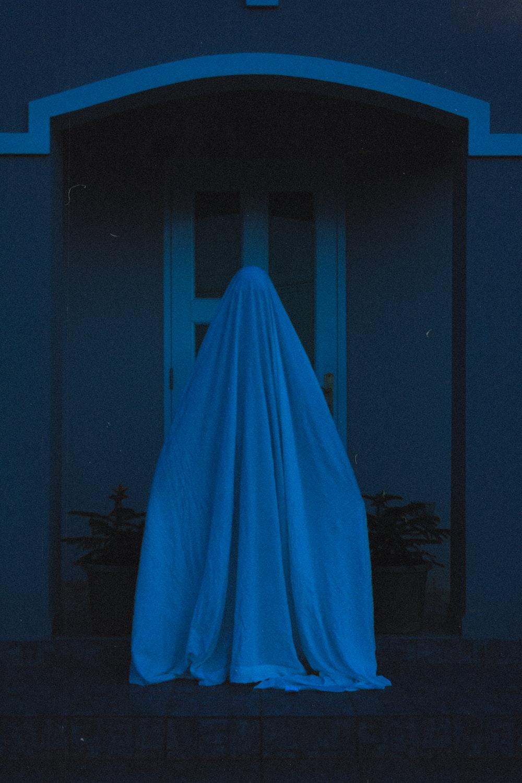 blue textile on dark room