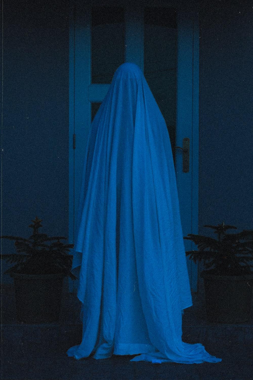 blue curtain near black wooden table