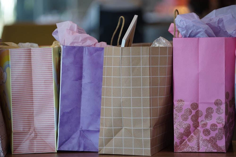 purple and white paper bags