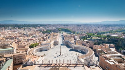 aerial view of city during daytime vatican city zoom background