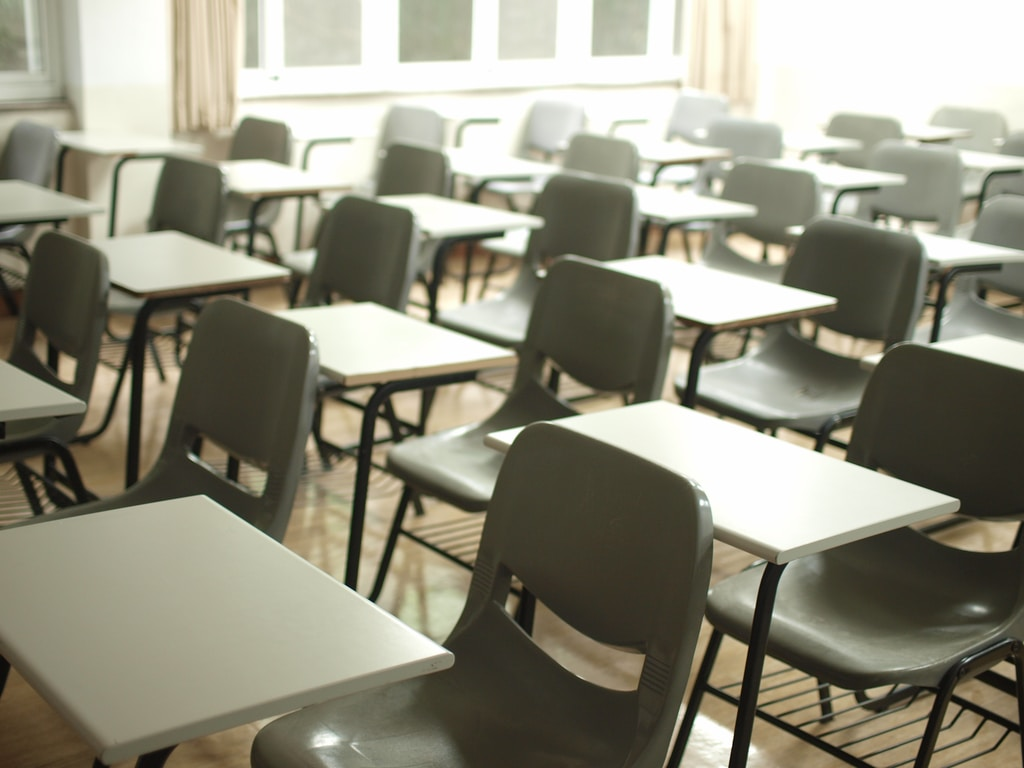 School clean white table with black chairs