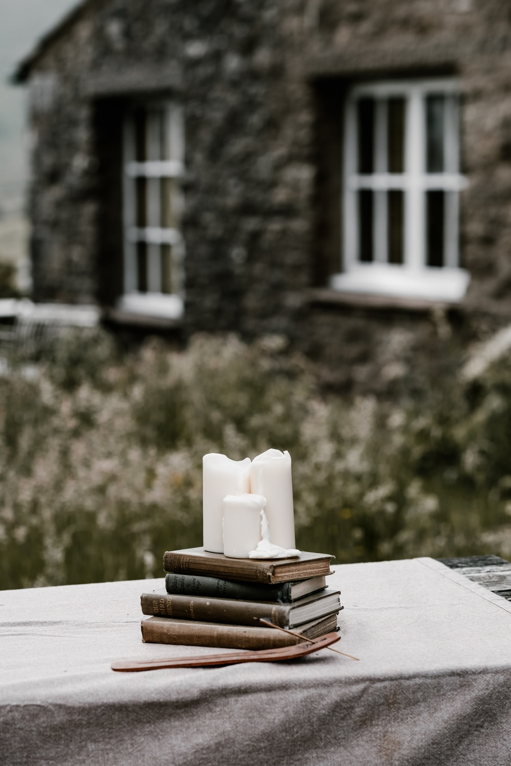 white ceramic candle holder on book page
