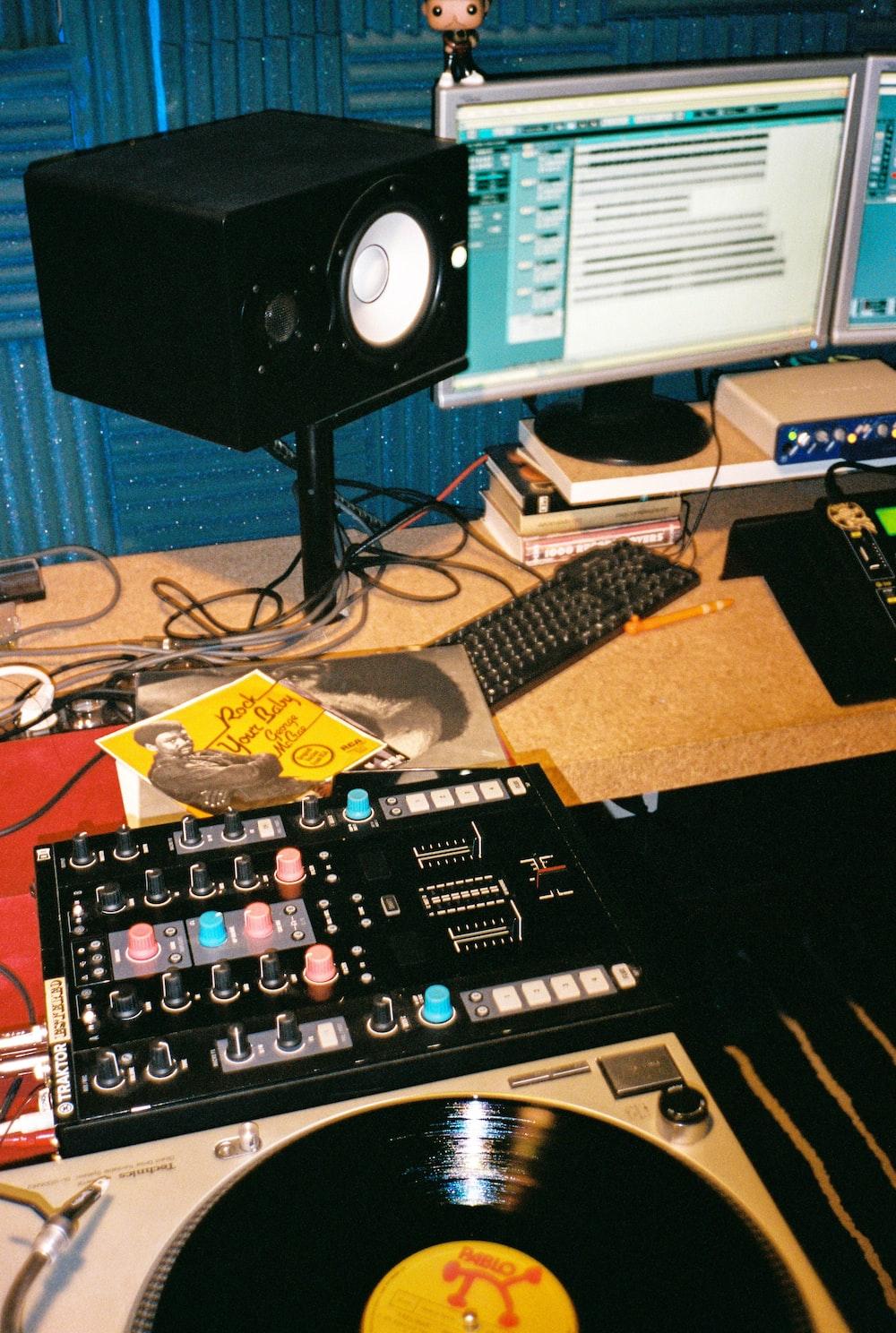 black audio mixer beside black computer keyboard