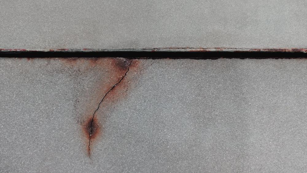 black metal bar on gray concrete floor