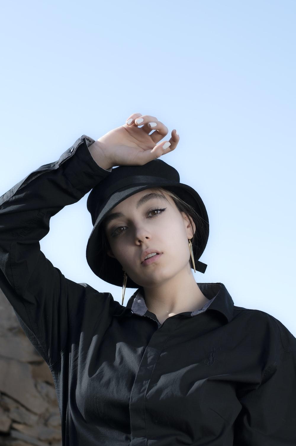 woman in black hoodie wearing black cap