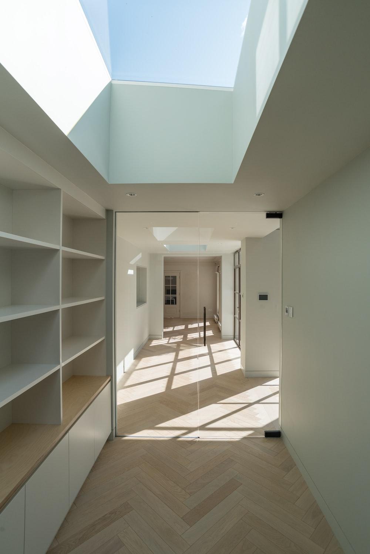 white wooden shelf near white wall