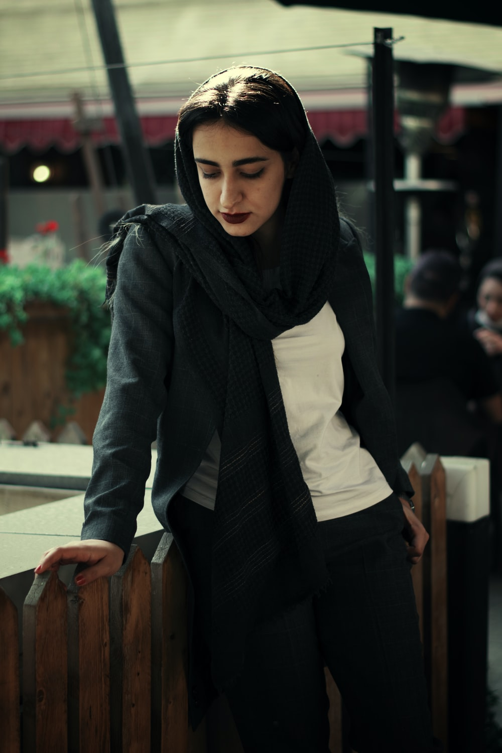 woman in black hijab and white long sleeve shirt